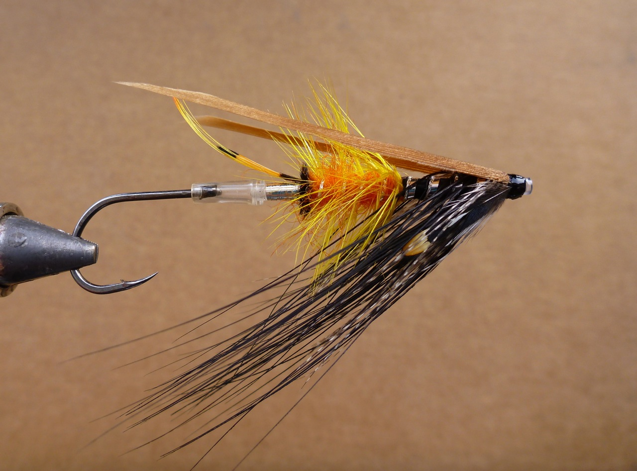 The Akroyd Dee It was originally tyed back in the late 1800's, Kelson (1895) and later Pryce-Tannatt (1914) both listed this fly in their books on Dressing Salmon Flies. Dee style flies were named after the river Dee in Scotland, as were Spey (river Spey) and Don flies (river Don) etc. These styles were later fished on many different rivers world wide for Atlantic Salmon & Steelhead (Haig-Brown). The Akroyd pictured here was tyed yesterday and will be fished. I've also took the liberty to tye it in different colours & vary it a bit. The Dee style wing stabilizes the hook so it swims true (hook down). Spin one up and give it a go !!  The Akroyd (pictured) tag: silver tinsel tail: a topping and tippet in strands butt: black herl body; rear half light orange seal's (sub) fur, front half black floss hackle: yellow hackle over the orange, heron (sub) over the black floss rib: oval silver over the orange seal's fur, flat silver and twist over the floss throat: teal wing: cinnamon turkey cheek: jungle cock  Material Source: www.canadiantubeflies.com First Cast Fly Shop; 519-766-4665 Guelph Book Source: Spey Flies & Dee Flies; John Shewey Spey Flies, how to tie them; Bob Veverka Salmon Patterns; Mike Radencich