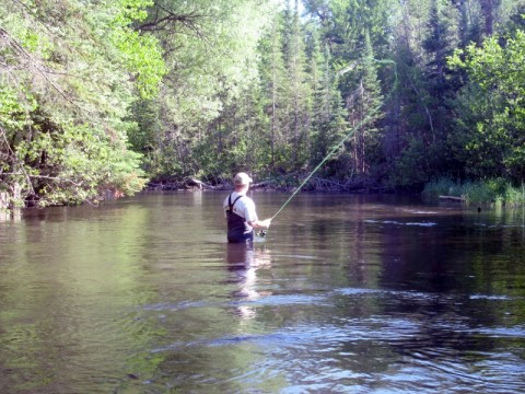 Me fishing the mainstream of the Au Sable.