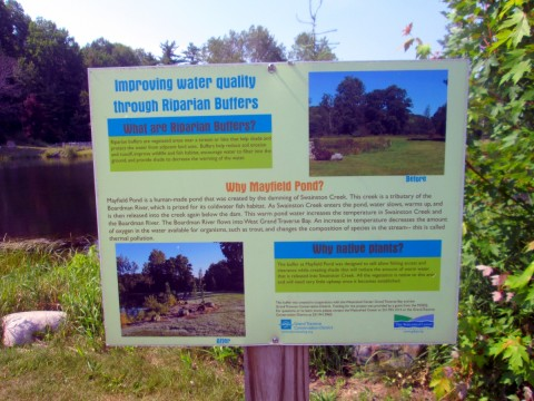 A sign explaining the functionality of Mayfield Pond.