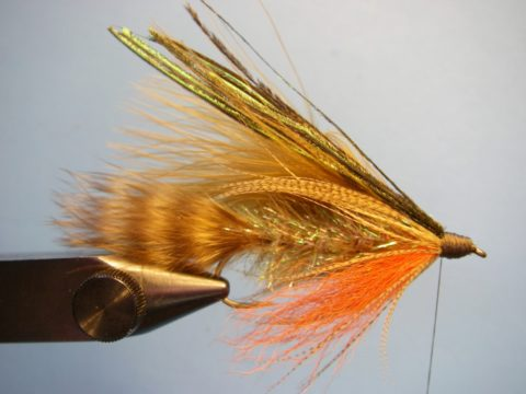 Build a large, smooth thread head and whip finish. On flies like this, I like to apply twothin coats of Sally Hansen's clear nail polish to both protect the threads and put a nice finish on the fly.