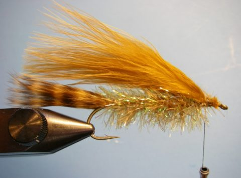 Tie in a full marabou feather on the top of the hook with the tips extending to the tail.